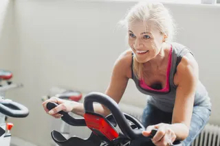 woman-riding-exercise-bike